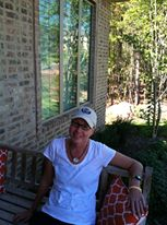 Home, relaxing on the front porch.